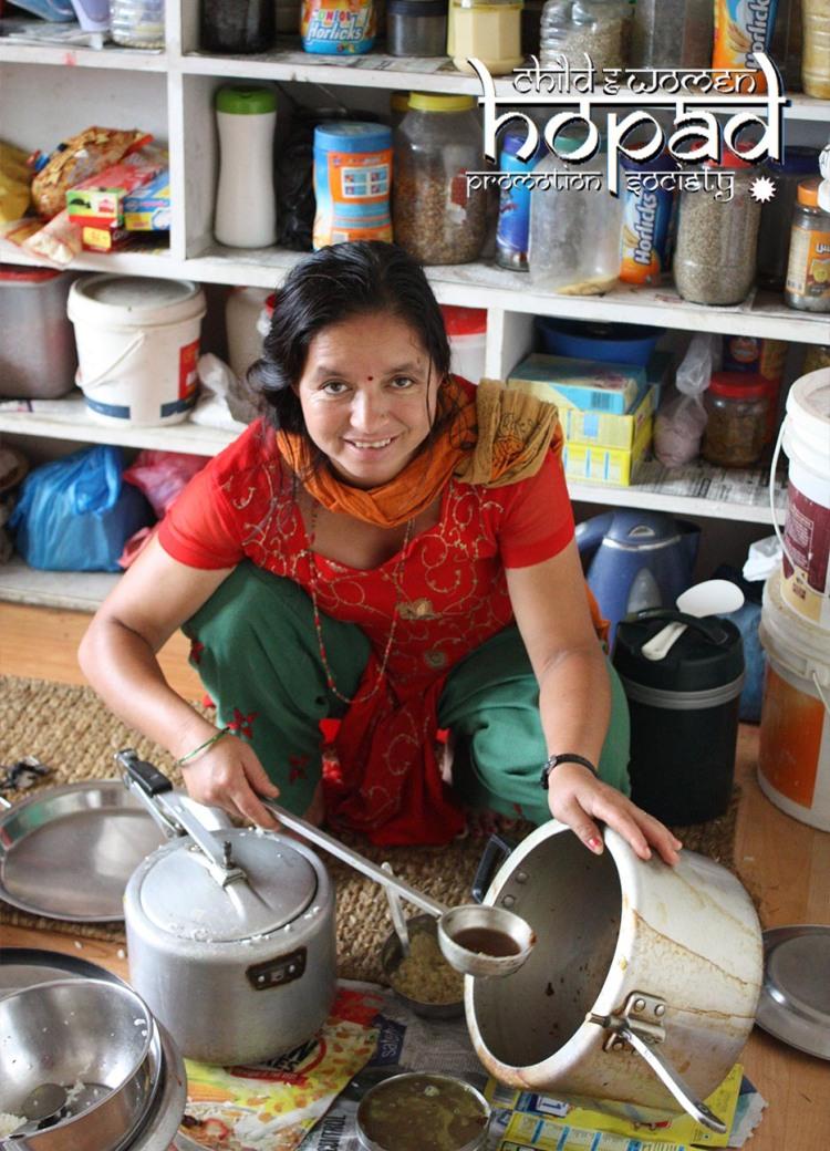 Didi Serving Dal Bhat